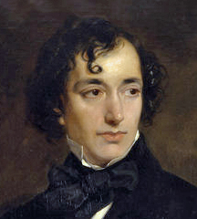 A young man of vaguely Semitic appearance, with long and curly black hair