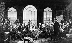 men gathered around conference table in front to windows
