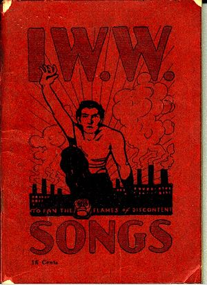 "Booklet cover with large title, ""IWW Songs"", and illustration of a man climbing over a hill, reaching skyward, with factories in the background."