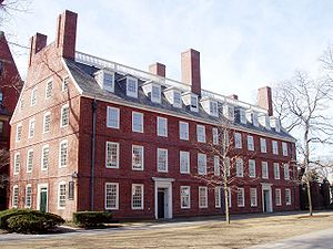 A four story brick building with many windows.
