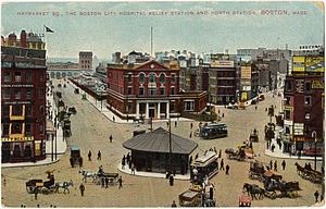 Colored print image of a city square in the 1900s