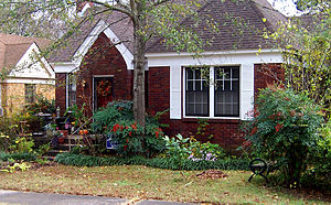 A small, one-story brick-faced house with a small yard in front. This house is located in Little Rock, Arkansas. Hillary Rodham and Bill Clinton lived in this house when Bill was Arkansas Attorney General from 1977 to 1979.