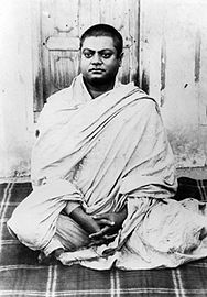Vivekananda sitting, wearing white shawl