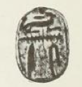 A small seal in the shape of a scarab inscribed with hieroglyphs spelling the name Unas.