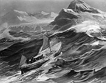 A small boat with two sails set climbs the steep side of a wave. In the background are the rocky tops of high cliffs and distant mountains