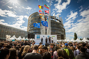 European Parliament opening in Strasbourg with crowd and many countries' flags on flagpoles