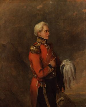 Portrait of a man looking to the viewer's right. He wears a red military coat and dark blue trousers and is shown standing from head to knee in front of an indistinct brownish landscape.