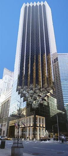 a view upward toward the top of the Trump Tower, a 58-floor building with a brown-glassed facade