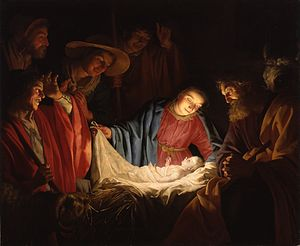A Nativity scene; men and animals surround Mary and newborn Jesus, who are covered in light