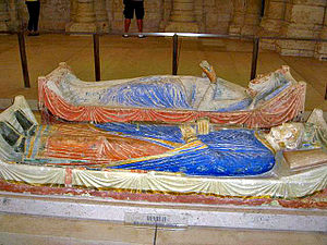 Painted statues of reclining king and queen