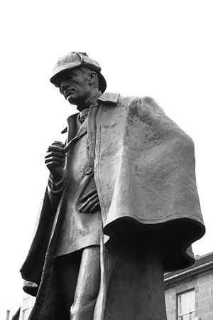 Statue of Holmes, holding a pipe