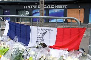 The French Tricolored Flag is on Display Outside the Hyper Cacher Kosher Market (16291418132).jpg