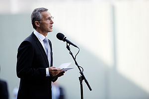 Jens Stoltenberg speaking at a podium.