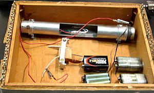 A bomb with wires in a wooden box
