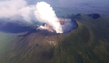 An aerial view of the towering volcanic peak of Mt. Nyiragongo.jpg