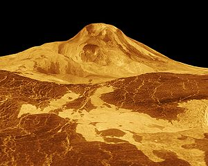 Image is false-colour, with Maat Mons represented in hues of gold and fiery red, against a black background