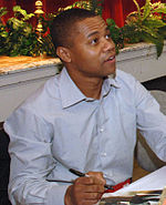 Photo of Cuba Gooding Jr. signing autographs in 2006.