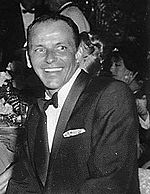 Black and white photo of Frank Sinatra at Girl's Town Ball in Florida (1960).