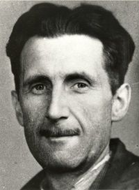 A black-and-white photograph of Orwell: a Caucasian man with a thin mustache