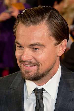 Leonardo DiCaprio is smiling away from the camera.