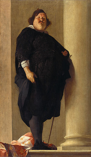 A very obese gentleman with a prominent double chin and mustache dressed in black with a sword at his left side.