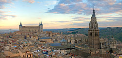 Toledo at sunrise — The Alcázar on the left and Cathedral on the right dominate the skyline