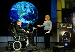 Hawking and his daughter Lucy on stage at a presentation