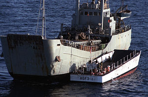 Iran Ajr with mines visible on deck and a U.S. Navy landing craft alongside, 22 September 1987