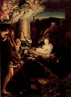 Nativity scene with angels and cherubs in the upper left-hand corner. Light is emanating from the center of the picture, where the Christ child is positioned, creating shadows and light all around the central group of Mary and the shepherds. Joseph and some animals are in the background.