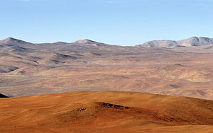 Atacama Desert in foreground with Andes mountains in distance