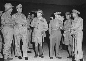 Six men wearing a variety of different uniforms.