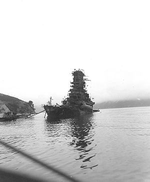 a heavily damaged Haruna, having sunk from the stern, several days after coming under attack at her moorings