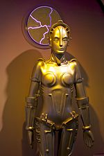 A replica of a gold-plated feminine robot.