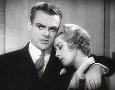 Cagney with his arm around actress Joan Blondell, who has her eyes closed.