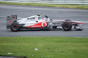 McLaren driver Jenson Button celebrating his victory in the Canadian Grand Prix