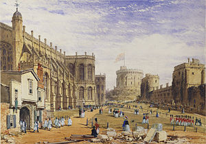 A painting showing a stone chapel on the left, with a timber built entrance, out of which are parading a number of white clad individuals. In the middle of the painting is a grassy area, across which are marching various red-uniformed soldiers. On the right hand side is a line of stone buildings, with a circular tower on a mound in the far distance.