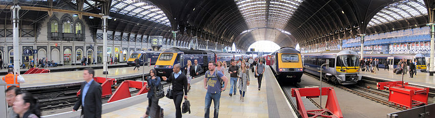 The platforms inside the train shed at London Paddington station. Three of the platforms are occupied by First Great Western High Speed Trains, while another two have Heathrow Express units