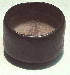 Photo of a tea bowl, dark-coloured, humble, and asymmetric.