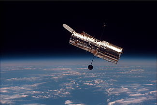The Hubble Space Telescope as seen from the Space Shuttle Discovery on mission STS-82.