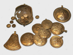 Iron Age metal plates and buttons from a hoard