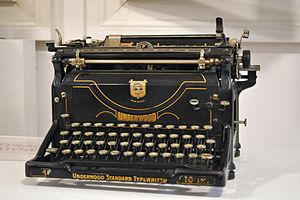 Photograph of a tall, black typewriter