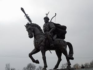 Modern statue of Jin emperor Taizong on horseback holding a weapon