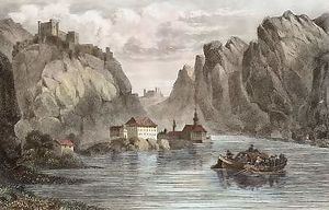 A river (Danube) flows in a steep-sided valley. To one side stands a medium-sized Abbey, and a castle, in ruins, overlooks the valley. A boat floats in the middle of the river.