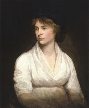 Left-looking portrait of a slightly pregnant woman in a white dress