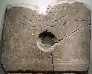 Sobekhotep III worshipping Satet. The central hole was made when the relief was used as a grinding stone, long after the original carving. Now on display at the Brooklyn Museum.