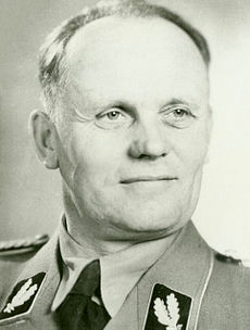A black-and-white photograph of the head and shoulders of a man in his mid-forties, looking to the right of the viewer. He is wearing a Second World War German military uniform.