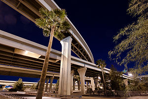 "photo showing the multiple levels of roadways at the interchange between Interstates ten and seventeen, called ""the stack"" in downtown Phoenix at night."