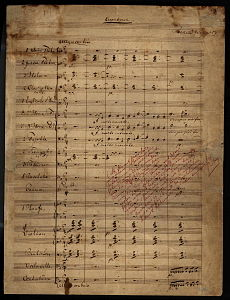 "Six bars of music are written across 19 pre-printed staves. The page is headed ""Overture"". Below the heading to the right is Wagner's name. The tempo indication is allegro con brio. Several lines are written diagonally in lighter handwriting."
