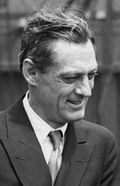 Black and white photo of Lionel Barrymore—a middle-aged white man in profile, with straight hair, wearing a sophisticated suit and smiling, in 1923.