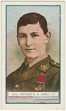 Head and shoulders of a young British officer. He is Caucasian with brown hair that is parted to the right. He is wearing a military uniform with the Victoria Cross pinned to the left breast.
